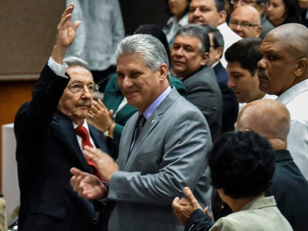 Cuban President Raul Castro waves to the room as First Vice President Miguel Diaz-Canel, Castro's handpicked successor, claps at the National Assembly session Wednesday in Havana.