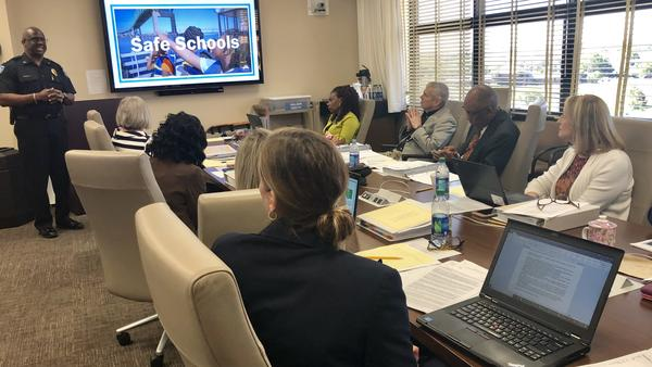 The Duval County School District Board reviews a plan to hire school safety assistants.