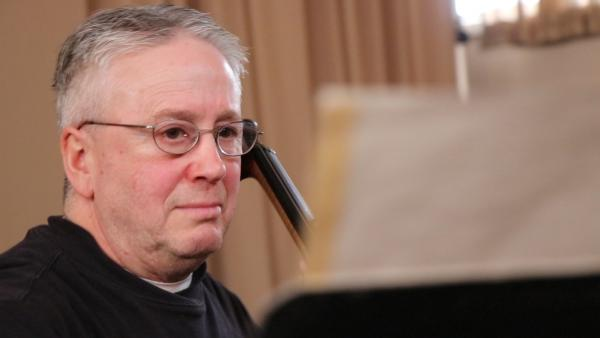 Hausmann intently reading Ravel's Kaddish Song