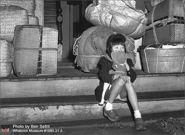 Pat Kawabata, pictured here at age six awaiting transport from Bellingham to a World War II internment camp, is returning to attend the installation of the arch.
