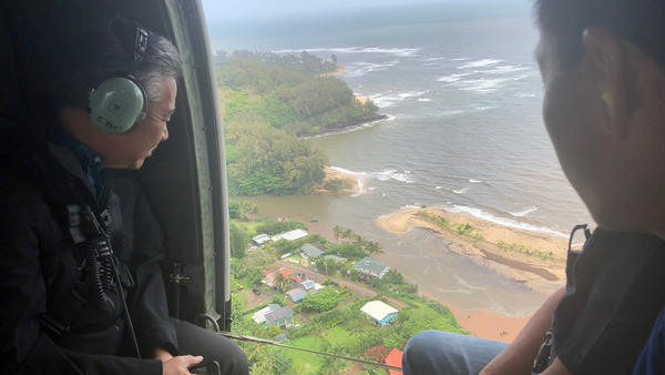 Hawaii Gov. David Ige (left) flies over the flood-damaged areas of the island of Kauai on Monday, assessing the damage and rescue needs on the island. Hawaii is bracing for even more rain over the next two days