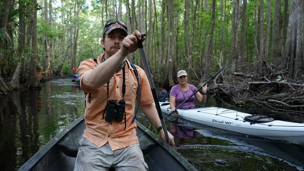 Florida Wildlife Corridor expedition members Joe Guthrie and Mallory Lykes Dimmitt paddle on Reedy Creek in Celebration Thursday.