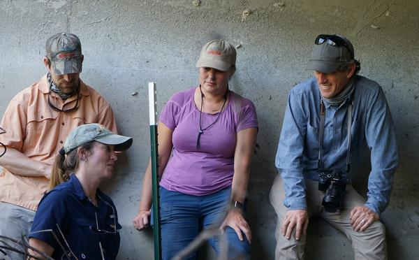 Wildlife biologist Dr. Jennifer Korn (front) talks to expedition members Joe Guthrie (back, from l-r), Mallory Lykes Dimmitt and Carlton Ward Jr. about wildlife that crosses under I-4.
