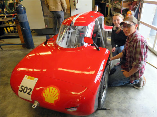 Granite Falls High School Eco Car Team drivers Kelsey and Demetri beside their 520 mpg ''UrbanConcept'' vehicle.