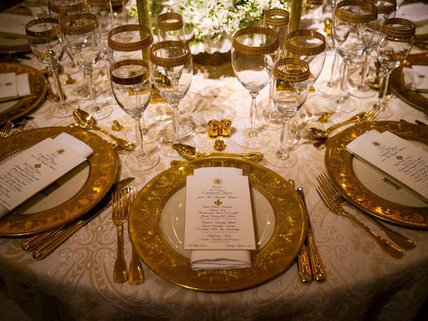 Dinner china is set before President Donald Trump and first lady Melania Trump host French President Emmanuel Macron and his wife, Brigitte Macron, for the first state visit of the Trump administration, in the State Dinning room of the White House, on April 23, 2018 in Washington, DC.