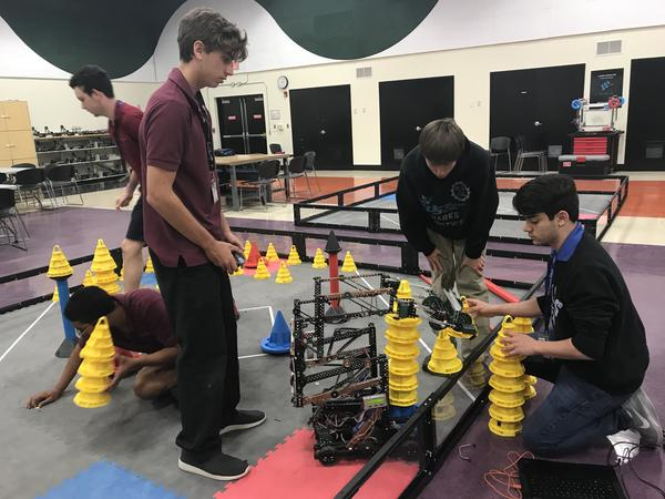 One of the two teams that NSU University School is sending to the Vex World Championships, tests out their robot before the trip.
