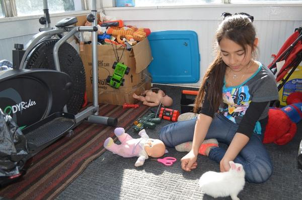 <p>Ten-year-old Azul plays with her pet rabbit at her family's home in Wapato, Washington.</p>