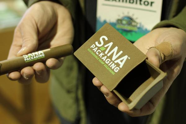 A retialer shows off plastic packaging derived from hemp.