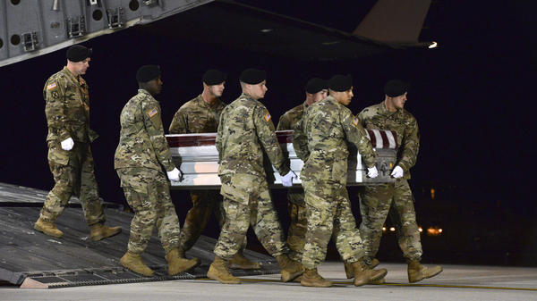 A U.S. Army team transfers the remains of Staff Sgt. Dustin Wright, 29, of Lyons, Ga., at Dover Air Force Base, Del., on Oct. 5, 2017. Wright was one of four U.S. troops killed in an ambush in Niger.