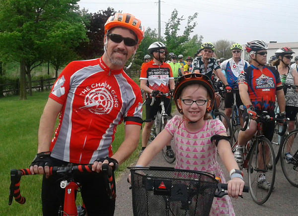 "Paul Gobble with his daughter Emma on the ""Ride of Silence."""