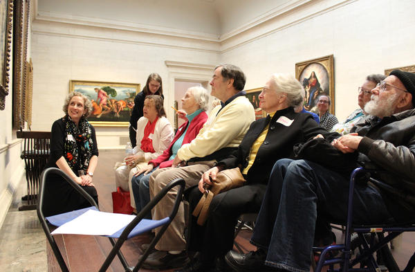 Lorena Bradford (left), head of accessible programs at the National Gallery of Art in Washington, D.C., leads a session of the museum's <em>Just Us</em> program. The program gives adults with memory loss and their caregivers a chance to explore and discuss works of art in a small-group setting.