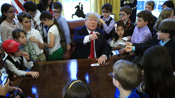 President Trump is surrounded Thursday by kids in the Oval Office on Bring Our Daughters and Sons to Work Day.