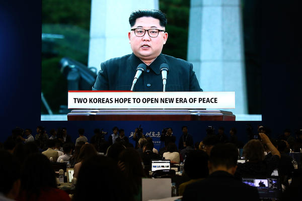 A huge screen shows live video of North Korean leader Kim Jong Un at a press center for the Inter-Korean Summit in Goyang, South Korea.