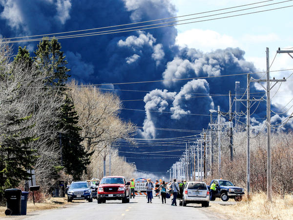 Thick plumes of smoke rise from the Husky Energy oil refinery in Superior, Wis., which was hit by an explosion and a series of fires on Thursday.