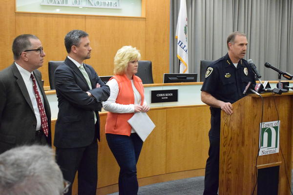 Normal Police Chief Rick Bleichner, right, with Coroner Kathy Davis and McLean County State's Attorney Jason Chambers, second from left, at a press conference Thursday, April 26, 2018.