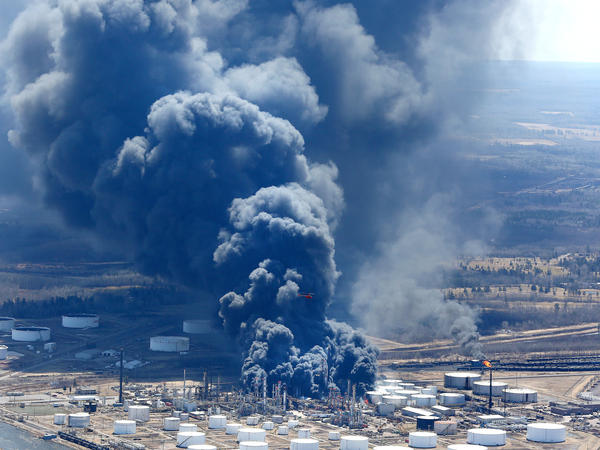 Dark smoke rises from the Husky Energy oil refinery in Superior, Wis., following an explosion Thursday.
