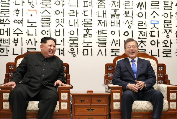 North Korean leader Kim Jong Un, left, and South Korean President Moon Jae-in are in talks during the Inter-Korean Summit.