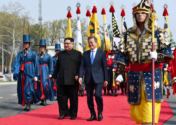 After crossing the demarcation line, Kim and Moon walk to the official welcome hall for the first North-South summit in more than a decade.
