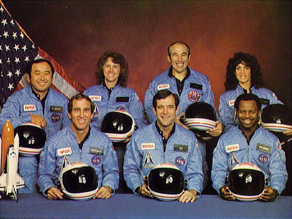 Space Shuttle Challenger crew members (Back, L-R) Mission Specialist Ellison S.  Onizuka, Teacher-in-Space participant Sharon Christa McAuliffe, Payload  Specialist Greg Jarvis and mission specialist Judy Resnick. (Front, L-R) Pilot  Mike Smith, commander Dick Scobee and mission specialist Ron McNair.