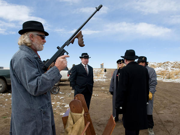 """Jack """"Machine Gun"""" McGurn holds his Tommy gun as he prepares to participate in the first caper of the day."""