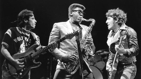 Nils Lofgren, Clarence Clemons and Bruce Springsteen onstage.