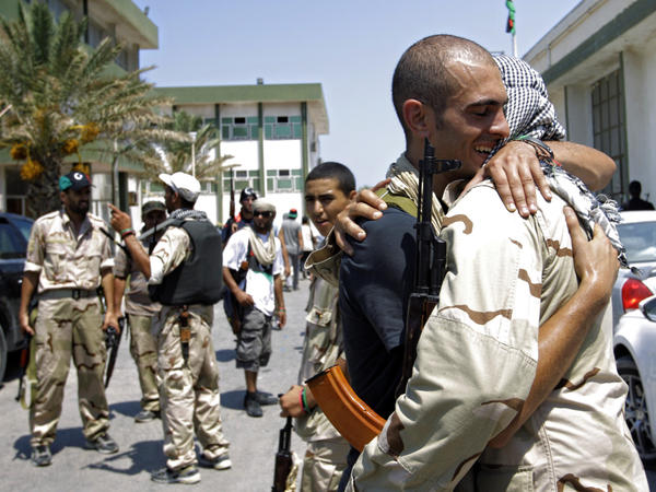 Libyan rebels embraced Monday at the former female military base in Tripoli after opposition fighters raced into the capital in a lightning advance the day before.
