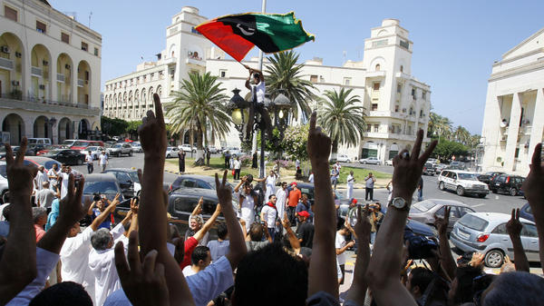 Libyans celebrate after prayers at a mosque next to the newly named Martyrs Square in Tripoli on Friday.