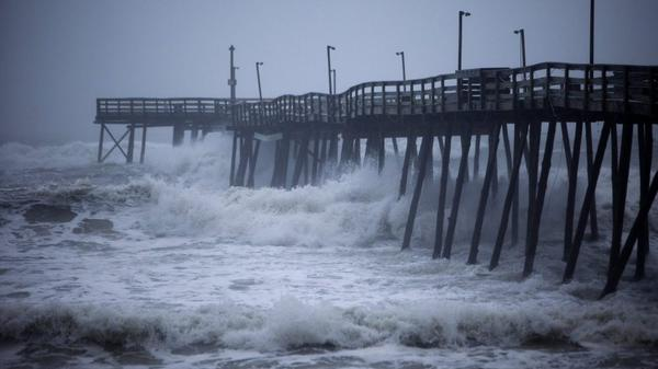 Waves crash into Avalon Pier as Hurricane Irene strikes the Outer Banks in Kill Devil Hills, N.C. earlier today.