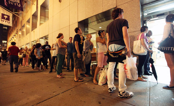 People stand in line at a Trader Joe's Wine Shop in Manhattan Friday, ahead of Hurricane Irene's arrival in New York City this weekend.