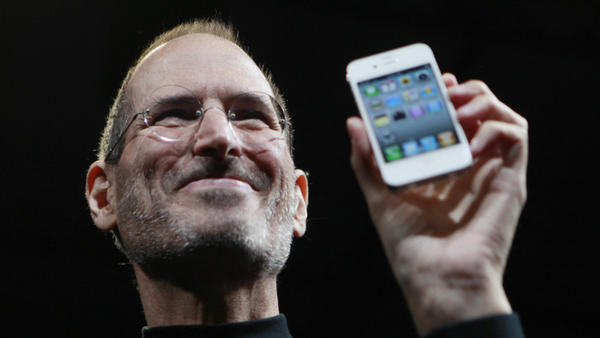 Steve Jobs holds up an iPhone at the Apple Worldwide   Developers Conference in San  Francisco in June 2010. Jobs resigned as Apple's CEO on Wednesday.
