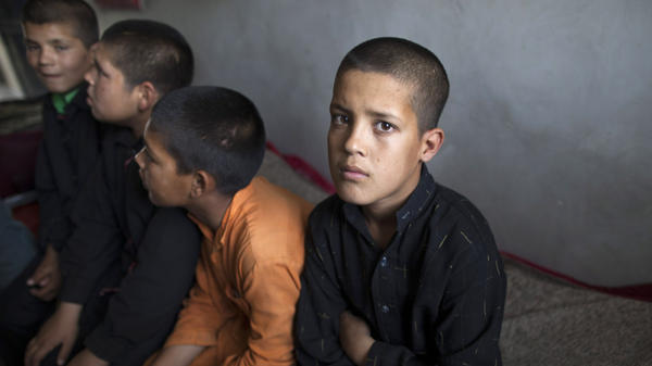 Incarcerated children sit at the Kabul Juvenile Rehabilitation Center May 18, in Kabul, Afghanistan. The four boys were believed to have been recruited by the Taliban as suicide bombers. In an end-of-Ramadan tradition, President Hamid Karzai recently ordered the release of two dozen children held as suspected suicide bombers.