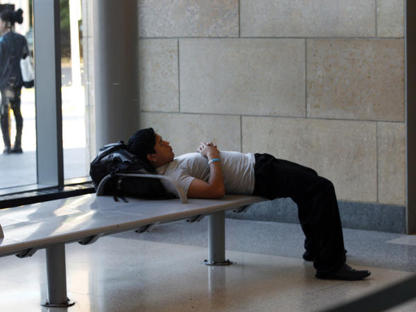 A man rests at the Trenton, N.J., train station on Monday, where some commuters were caught off guard when they found there were no trains. Damage from Hurricane Irene forced New Jersey Transit to suspend rail service.