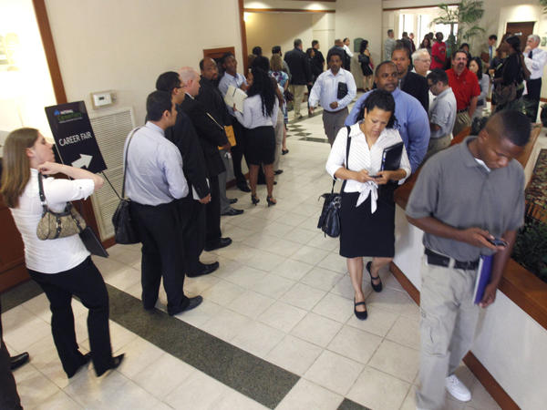 Job seekers line up to see recruiters during a career fair in Plano, Texas, on Aug. 15.