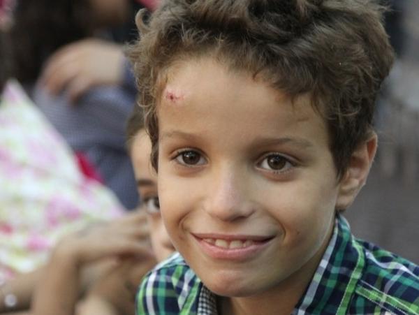 Jihad Anas, 10, celebrates Eid with his family.