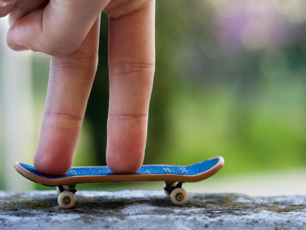 """Fingerboarding is a miniature version of skateboarding — competitors use tiny skateboards and """"skate"""" with their fingers. Fifteen people qualified for the national championship event held in New York City this weekend."""