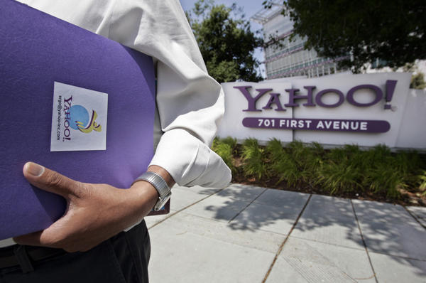 An employee leaves Yahoo headquarters in Sunnyvale, Calif. The company fired its chief executive officer earlier this week.