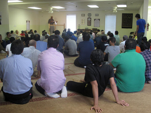 Men pray at the Islamic  Center of Murfreesboro. The congregation wants to build a bigger mosque to worship in, but has faced stiff opposition from citizens who fear the  local Muslims have a political agenda.