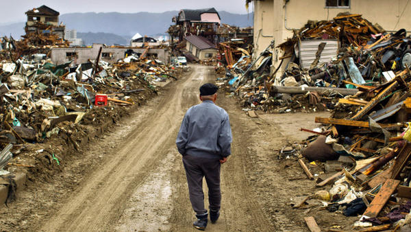 A 9.0-magnitude earthquake struck Japan offshore on March 11, setting into motion a tsunami that engulfed large parts  of northeastern Japan and triggered a nuclear meltdown at a power plant in Fukushima. On March 26, a man walks among debris in Rikuzentakata, Iwate Prefecture, Japan.