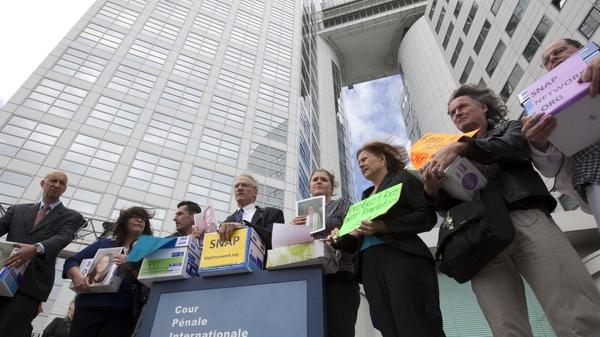 Members of the Survivors Network of those Abused by Priests pose in  front of the International Criminal Court in The Hague,  Netherlands, Tuesday. A group representing the victims is asking the world court to investigate top Vatican officials over the clerical sex abuse scandal.