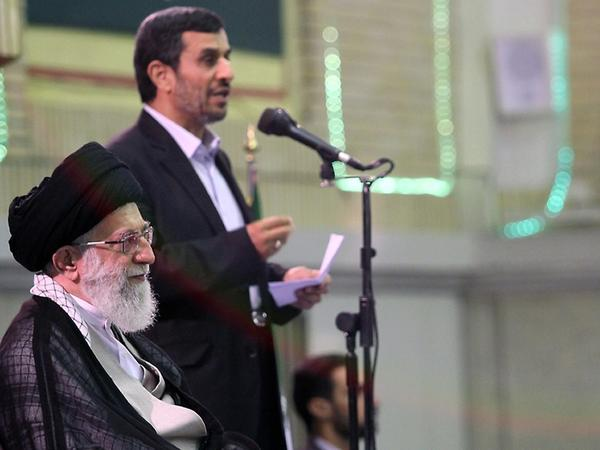 A handout picture released by the official website of Iran's Supreme Leader Ayatollah Ali Khamenei shows Khamenei listening to a speech by President Mahmoud Ahmadinejad (back) during a ceremony with other Iranian top officials and foreign ambassadors to mark the Muslim Eid al-Fitr feast in Tehran on Aug. 31, 2011.
