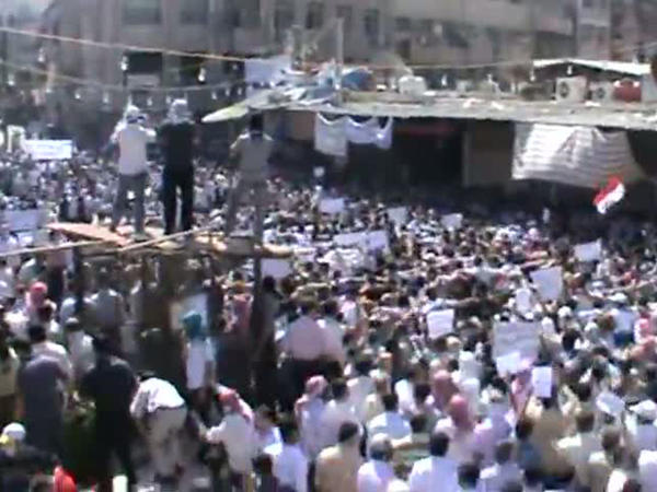 Footage from a YouTube video shows what Syrian activists said was a protest against President Assad's government in the Damascus suburb of Douma on Friday.