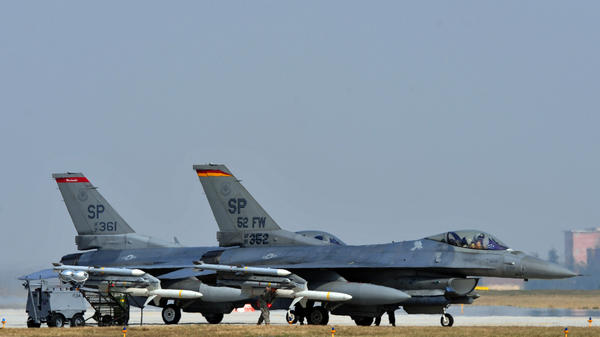 U.S. Air Force F-16 jet fighters sit on the tarmac at Aviano Air Base in Italy in March. The Air Force tested its jets on fuel made of 50 percent vegetable oil.