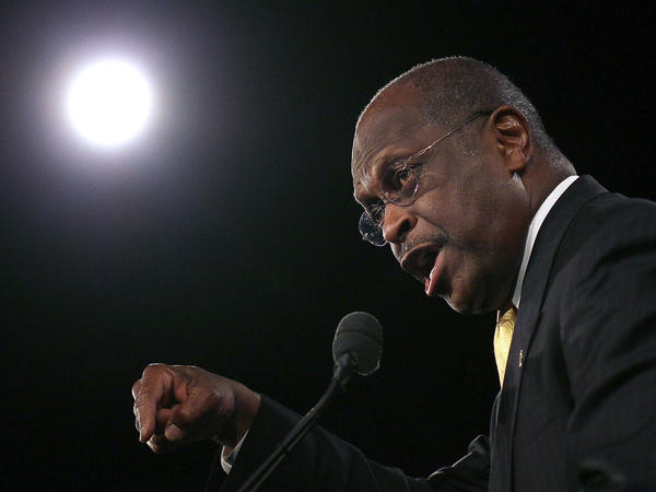 Republican presidential candidate Herman Cain speaks before Florida's straw poll at the Orange County Convention Center in Orlando on Saturday. Cain won the straw poll with 37 percent of the vote.