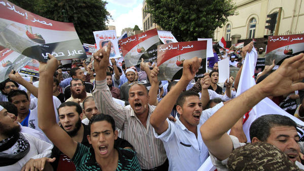 Egyptian demonstrators protest against the emergency law in front of the Interior Ministry in Cairo on Friday. The country's military rulers announced last week that the Hosni Mubarak-era measure would remain in effect until at least next June.