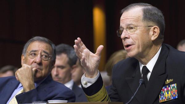 Defense Secretary Leon Panetta looks on at left as Joint Chiefs Chairman Adm. Michael Mullen testifies Thursday in Washington.