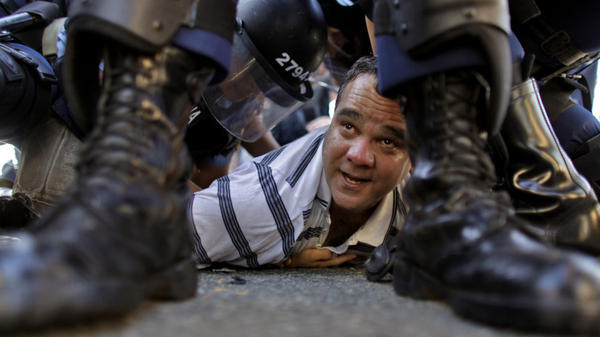 A student protester is detained by riot police at the University of Puerto Rico in San Juan, Puerto Rico on Jan. 19.  Students went on strike to demand that university officials eliminate a new $800 yearly fee that went into effect in January.