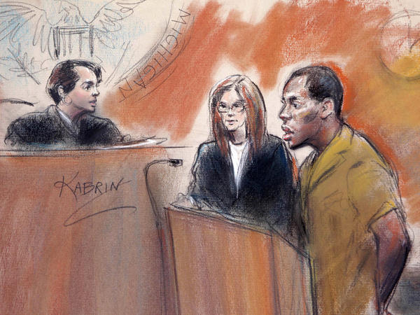 In this artist rendering, Umar Farouk Abdulmutallab stands with his attorney Miriam Siefer before U.S. District Judge Nancy Edmunds in federal court in Detroit, Sept. 13, 2010. Abdulmutallab, the Nigerian man charged with trying to blow up an Amsterdam-to-Detroit flight on Christmas in 2009, fired his lawyers and is now representing himself.