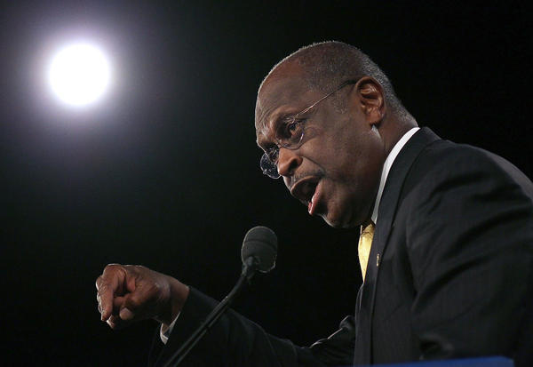 Republican presidential candidate Herman Cain speaks in Orlando, Fla., on Saturday. He won a GOP straw poll there with 37 percent of the vote.