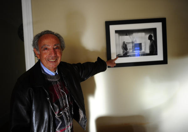 Former Chelsea Hotel manager Stanley Bard shows off a picture of actress Marilyn Monroe and playwright Arthur Miller taken in room 614 — where Miller lived during the 1960s. The artist community flourished under Bard's leadership for 50 years, before he was ousted by the hotel's board of directors in 2007.