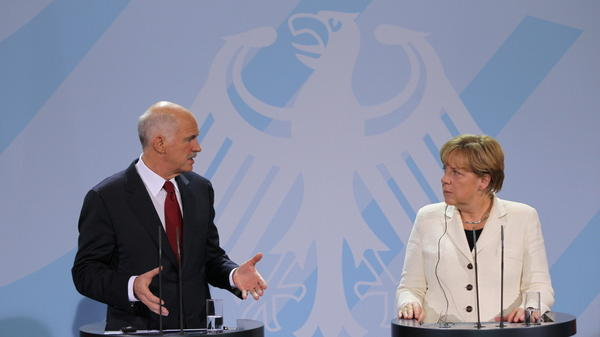 German Chancellor Angela Merkel and Greek Prime Minister George Papandreou speak during talks Tuesday in Berlin. Germany's lower house of parliament voted 523-85 to bolster the European bailout fund, which is designed to help Greece and other troubled countries.